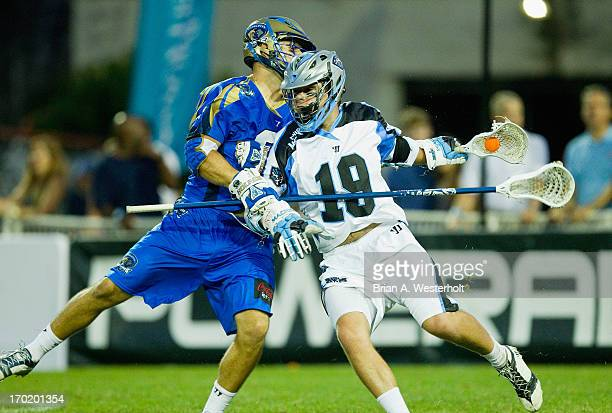 Joe Cummings of the Ohio Machine is checked by Joe Cinosky of the Charlotte Hounds during second half action at American Legion Memorial Stadium on...