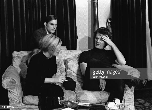 Joe Dallesandro and Andrea Feldman speak with director Paul Morrissey during a break while filming Andy Warhol's 'Heat' in October 1971