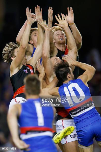 Joe Daniher and James Stewart of the Bombers fly for the mark against Tim English of the Bulldogs during the round three AFL match between the...