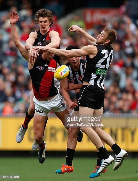 Joe Daniher and Kyle Langford of the Bombers compete for the ball with Brayden Maynard and Ben Reid of the Magpies during the 2015 AFL round 23 match...