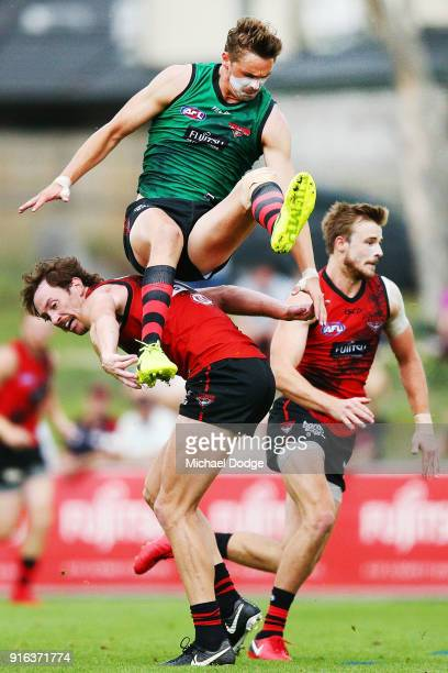 Joe Daniher attempts a high mark over Mitch Brown during the Essendon Bombers AFL IntraClub Match at The Hangar on February 10 2018 in Melbourne...