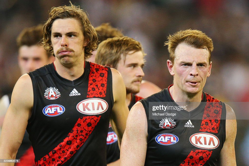 Joe Daniher of the Bombers (L) and Brendon Goddard walk off after defeat during the round five AFL match between the Collingwood Magpies and the Essendon Bombers at Melbourne Cricket Ground on April 25, 2016 in Melbourne, Australia.