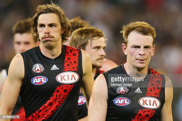 Joe Daniher of the Bombers and Brendon Goddard walk off after defeat during the round five AFL match between the Collingwood Magpies and the Essendon...