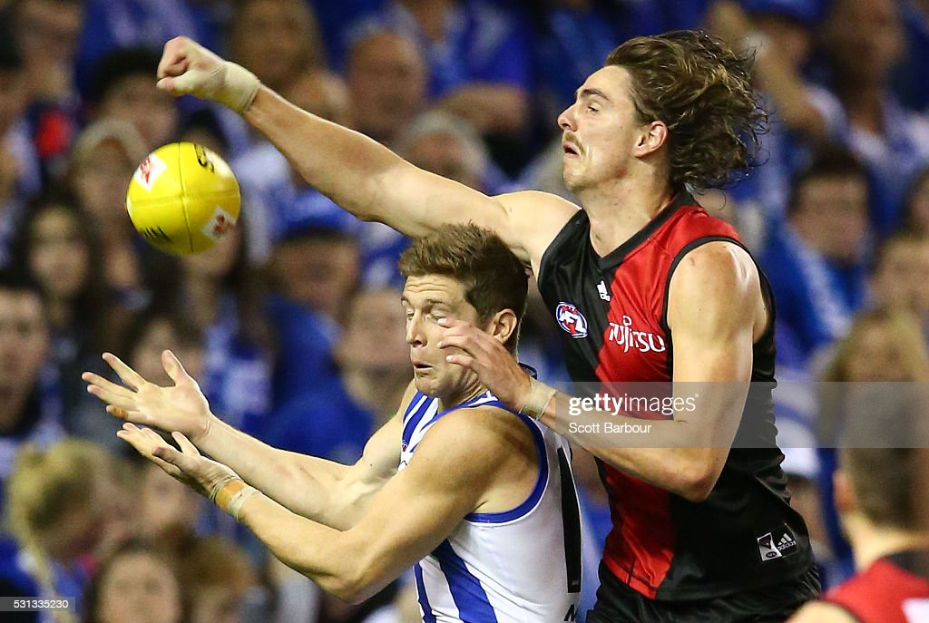 Joe Daniher of the Bombers and Nick Dal Santo of the Kangaroos compete for the ball during the round eight AFL match between the Essendon Bombers and the North Melbourne Kangaroos at Etihad Stadium on May 14, 2016 in Melbourne, Australia.