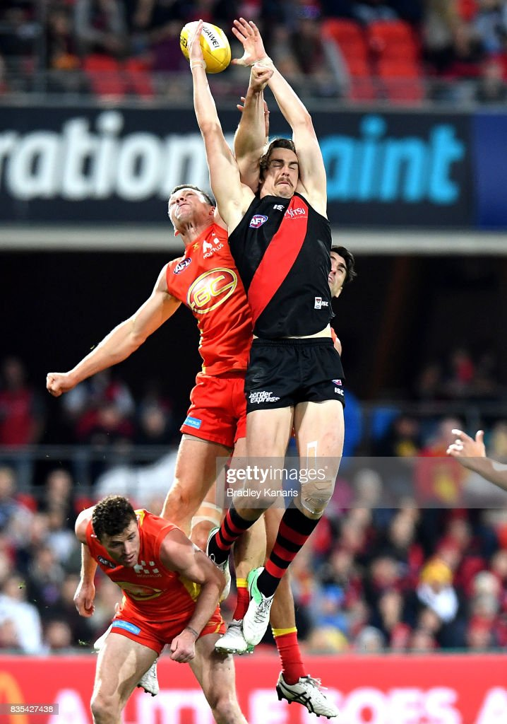 Joe Daniher of the Bombers and Steven May of the Suns compete for the mark during the round 22 AFL match between the Gold Coast Suns and the Essendon Bombers at Metricon Stadium on August 19, 2017 in Gold Coast, Australia.