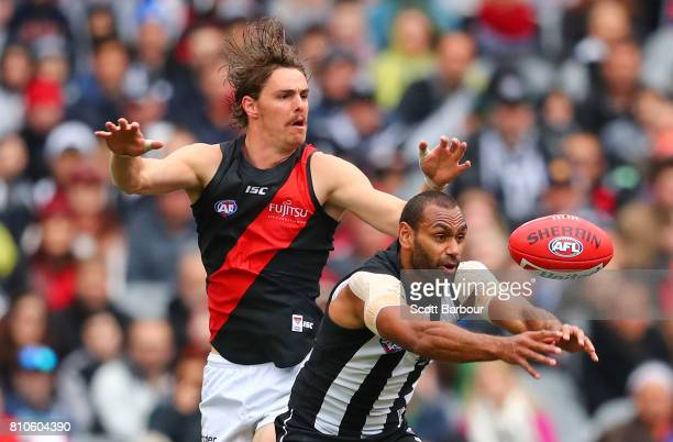 Joe Daniher of the Bombers and Travis Varcoe of the Magpies compete for the ball during the round 16 AFL match between the Collingwood Magpies and...