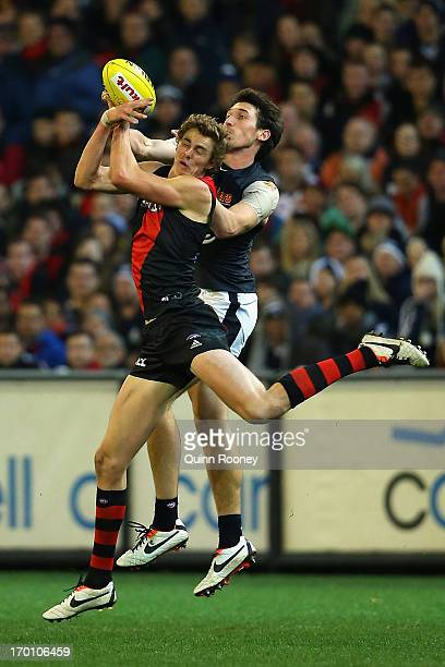 Joe Daniher of the Bombers attempts to mark infront of Michael Jamison of the Blues during the round 11 AFL match between the Essendon Bombers and...