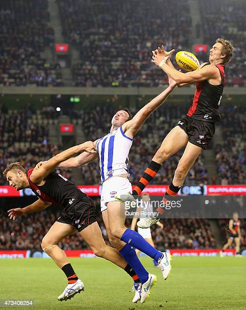 Joe Daniher of the Bombers attempts to mark over the top of Todd Goldstein of the Kangaroos during the round seven AFL match between the Essendon...