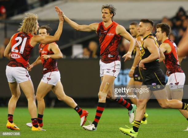 Joe Daniher of the Bombers celebrates a goal with Dyson Heppell of the Bombers during the round 10 AFL match between the Richmond Tigers and the...