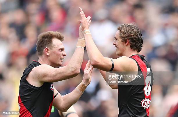 Joe Daniher of the Bombers celebrates after kicking a goal with Brendon Goddard of the Bombers during the round 23 AFL match between the Essendon...