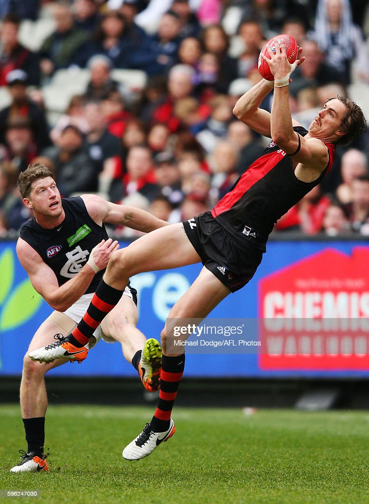 Joe Daniher of the Bombers compete for the ball against Sam Rowe of the Blues during the round 23 AFL match between the Essendon Bombers and the Carlton Blues at Melbourne Cricket Ground on August 27, 2016 in Melbourne, Australia.