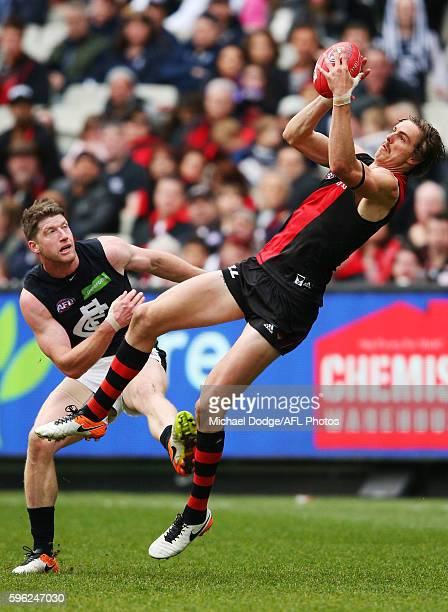 Joe Daniher of the Bombers compete for the ball against Sam Rowe of the Blues during the round 23 AFL match between the Essendon Bombers and the...