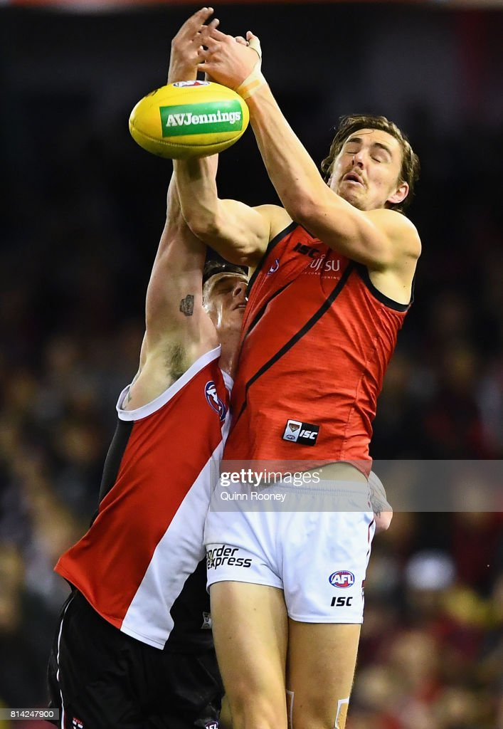 Joe Daniher of the Bombers marks infront of Jake Carlisle of the Saints during the round 17 AFL match between the St Kilda Saints and the Essendon Bombers at Etihad Stadium on July 14, 2017 in Melbourne, Australia.
