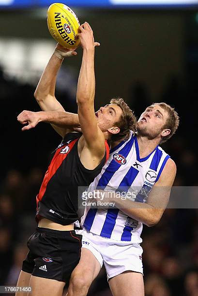 Joe Daniher of the Bombers marks infront of Luke Delaney of the Kangaroos during the round 21 AFL match between the Essendon Bombers and the North...