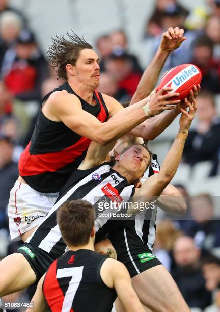 Joe Daniher of the Bombers marks the ball during the round 16 AFL match between the Collingwood Magpies and the Essendon Bombers at Melbourne Cricket...