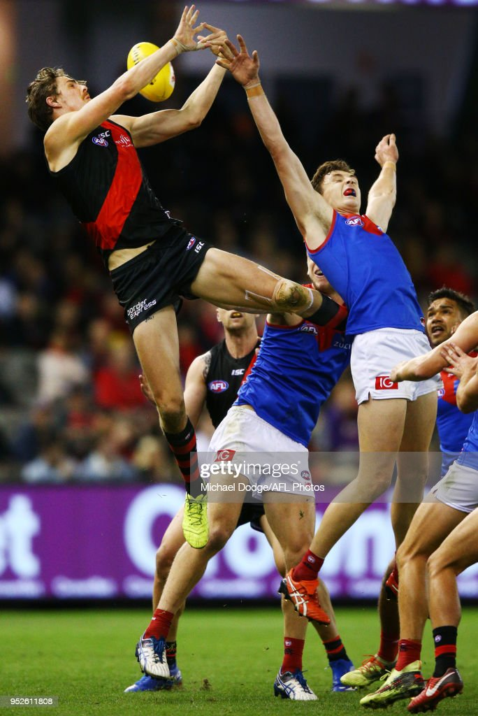 Joe Daniher of the Bombers marks the ball over Jake Lever of the Demons during the round 6 AFL match between the Essendon Bombers and Melbourne Demons at Etihad Stadium on April 29, 2018 in Melbourne, Australia.