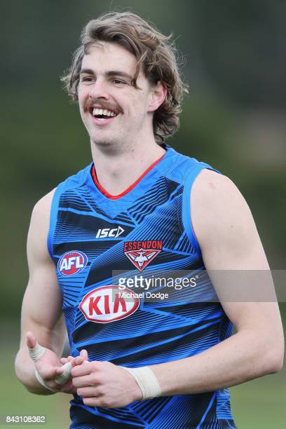 Joe Daniher of the Bombers reacts after ducking for cover from a ball during an Essendon Bombers AFL training session at the Essendon Football Club...