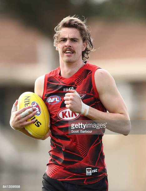 Joe Daniher of the Bombers runs with the ball during an Essendon Bombers AFL training session at the Essendon Football Club on September 1 2017 in...