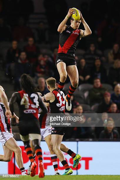 Joe Daniher of the Bombers takes a high mark during the round 16 AFL match between the Essendon Bombers and the St Kilda Saints at Etihad Stadium on...