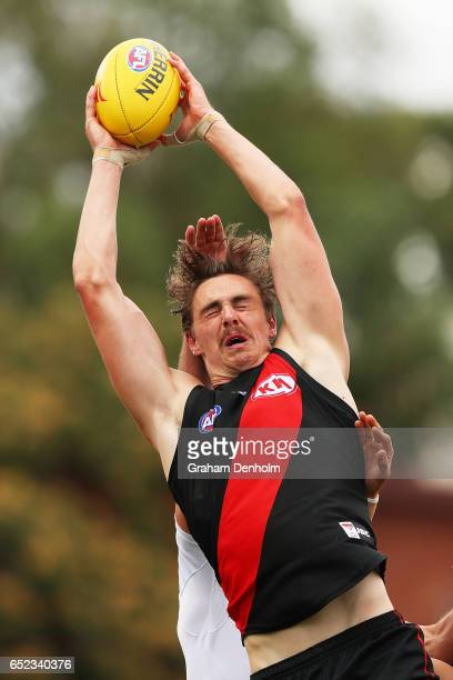 Joe Daniher of the Bombers takes a mark during the JLT Community Series AFL match between the Geelong Cats and the Essendon Bombers at Queen...