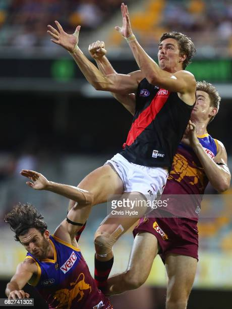 Joe Daniher of the Bombers takes a mark during the round two AFL match between the Brisbane Lions and the Essendon Bombers at The Gabba on April 1...