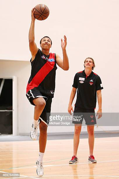 Joe Daniher of the Bombers watches young Australian basketball player Dante Exum drive to the hoop during an Essendon Bombers AFL media session at...