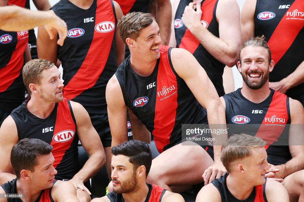 Joe Daniher sits on Cale Hooker during an Essendon Bombers team photo session at The Hangar on February 6, 2018 in Melbourne, Australia.