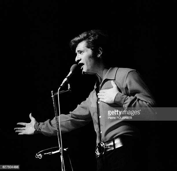 Joe Dassin on stage at the Olympia music hall