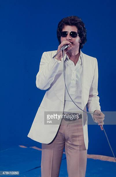 Joe Dassin sings the recording of the program ''System two''