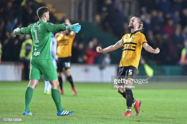 Joe Day and Fraser Franks of Newport County celebrate after the FA Cup Third Round match between Newport County and Leicester City at Rodney Parade...