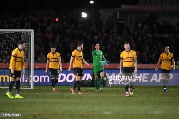 Joe Day of Newport County and teammates look dejected after conceding a second goal during the FA Cup Fifth Round match between Newport County AFC...