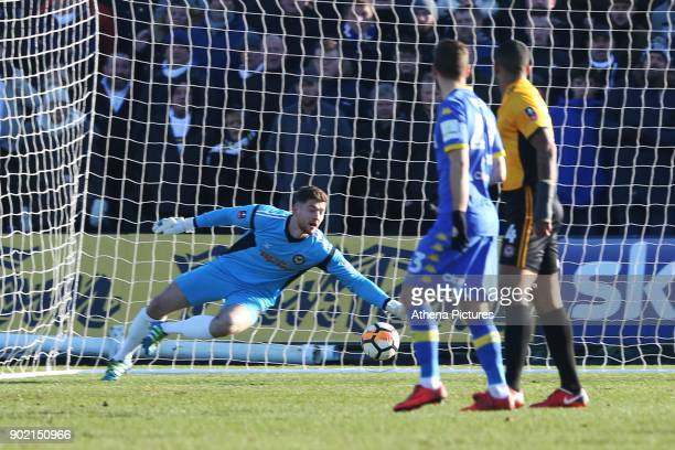 Joe Day of Newport County reaches for the ball as Gaetano Berardi of Leeds United scores his sides first goal of the match during the Fly Emirates FA...