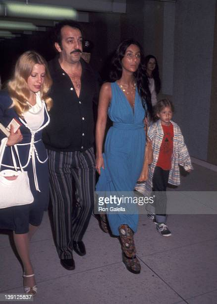 Joe de Carlo singer Cher and daughter Chastity Bono on March 20 1977 at Los Angeles International Airport in Los Angeles California