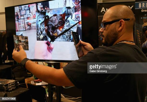 Joe De la Cruz demonstrates an augmented reality application in the Anomaly booth during the Amazing Las Vegas Comic Con at the Las Vegas Convention...