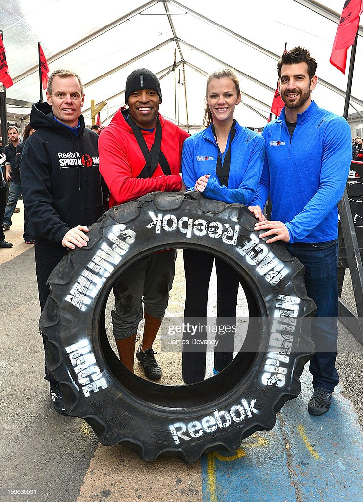 Joe De Sena, Spartan Co-founder, Tiki Barber, Brooklyn Decker and Chad Wittman, Director of Sports Marketing Fitness and Training at Reebok attend The Reebok Spartan Race Times Square Challenge in Times Square on January 17, 2013 in New York City.