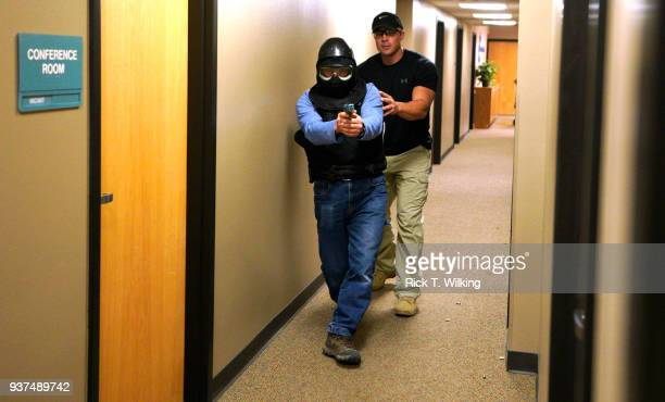Joe Deedon former law enforecement officer and owner of Tac*One Consulting guides a student in his 'Lone Wolf' civilian active shooter response...