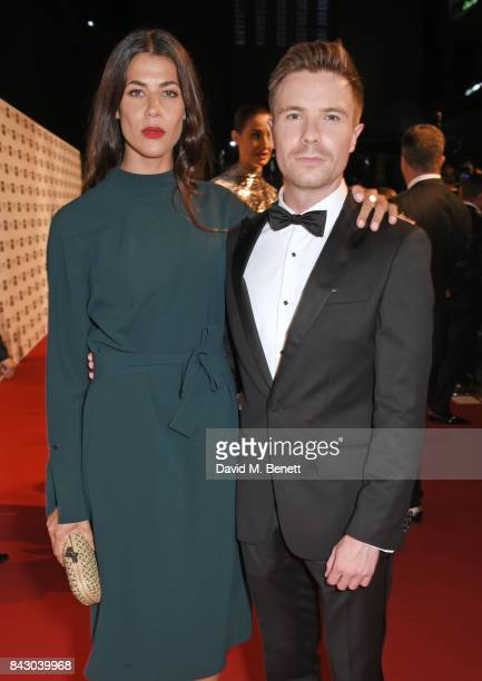 Joe Dempsie and Karima McAdams attend the GQ Men Of The Year Awards at the Tate Modern on September 5 2017 in London England