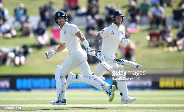 Joe Denly and Ben Stokes of England run between the wickets during day one of the first Test match between New Zealand and England at Bay Oval on...