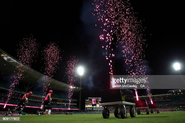 Joe Denly and Daniel Hughes of the Sixers take to the fieldduring the Big Bash League match between the Sydney Sixers and the Melbourne Stars at...