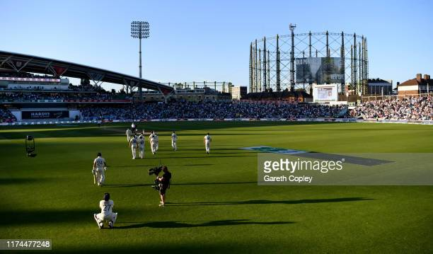 Joe Denly and Rory Burns of England walk out to bat during day two of the 5th Specsavers Ashes Test between England and Australia at The Kia Oval on...