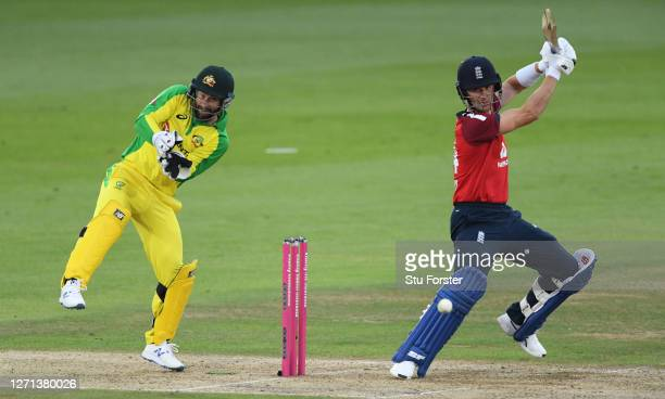 Joe Denly of England cuts the ball as Matthew Wade of Australia looks on during the 3rd Vitality International Twenty20 match between England and...