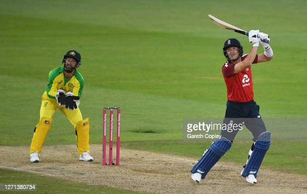 Joe Denly of England drives the ball for four as Matthew Wade of Australia looks on during the 3rd Vitality International Twenty20 match between...