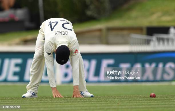 Joe Denly of England drops an easy catch from the bat of Kane Williamson of New Zealand during day 5 of the second Test match between New Zealand and...