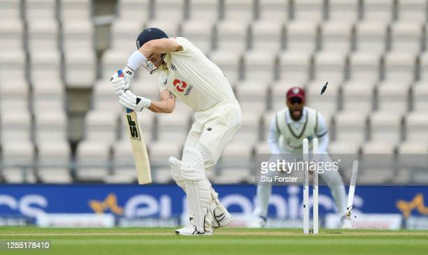 Joe Denly of England is bowled by Shannon Gabriel of the West Indies during day two of the 1st #RaiseTheBat Test match at The Ageas Bowl on July 09,...
