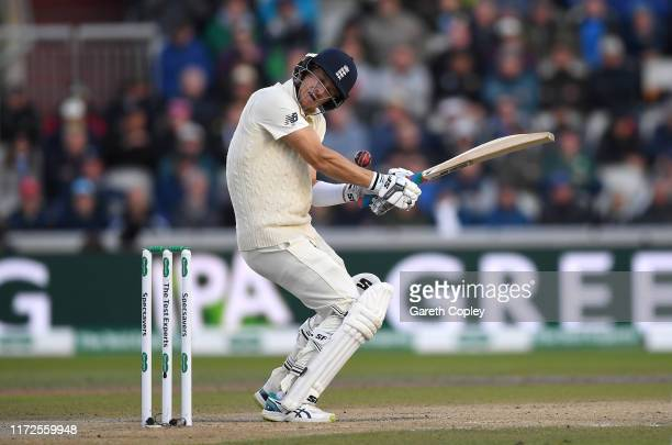 Joe Denly of England is hit by a short ball from Mitchell Starc of Australia during day two of the 4th Specsavers Ashes Test between England and...