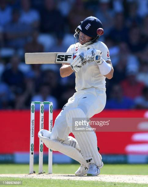 Joe Denly of England is hit on the helmet by a ball from Pat Cummins of Australia during day three of the 3rd Specsavers Ashes Test match between...