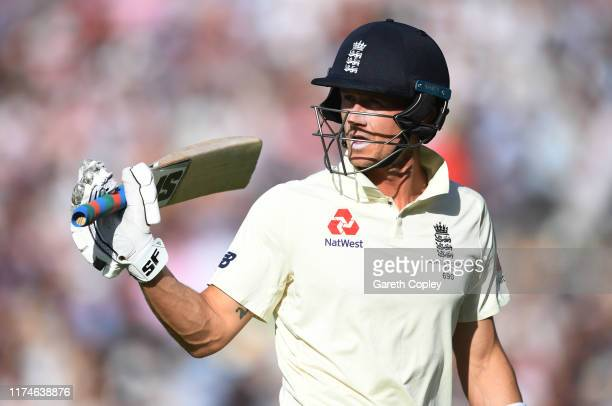 Joe Denly of England leaves the field after being dismissed for 94 runs by Peter Siddle of Australia during day three of the 5th Specsavers Ashes...