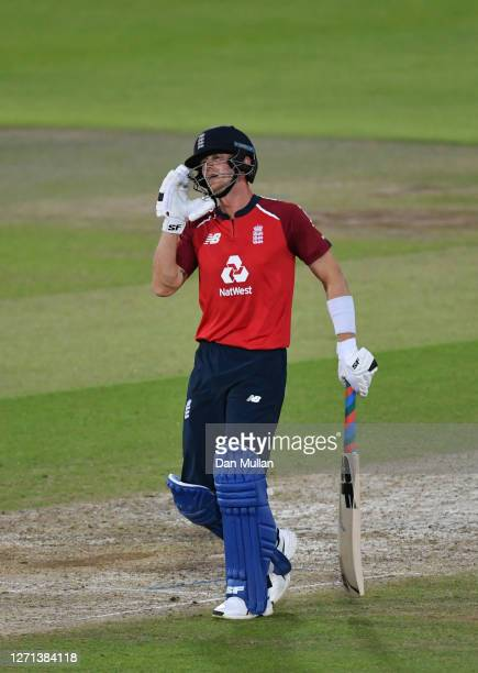 Joe Denly of England reacts after being hit on the head from a bouncer from Mitchell Starc of Australia during the 3rd Vitality International...