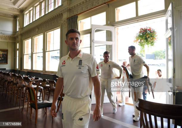 Joe Denly of England walks through the long room at Lord's Cricket Ground on August 13, 2019 in London, England.