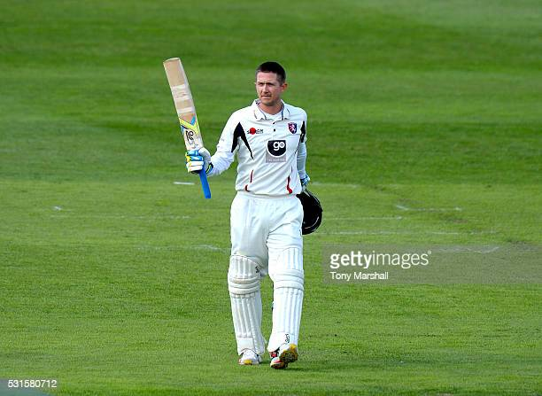 Joe Denly of Kent celebrates reaching his 100 during day one of the Specsavers County Championship Division Two match between Northamptonshire and...